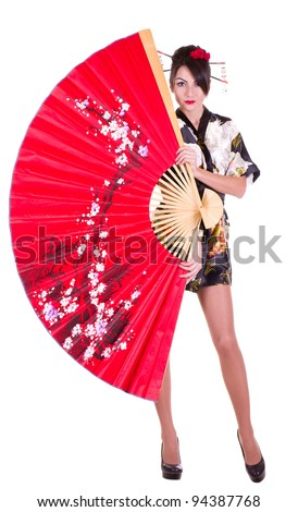Beautiful young woman in Asian costume with red Asian fan on white background. - stock photo