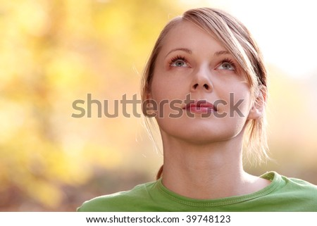 Beautiful young woman in autumn forest - stock photo