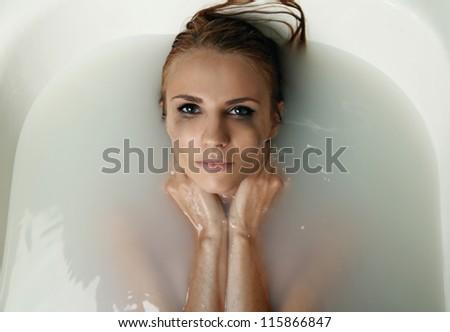 beautiful young woman in bath - stock photo