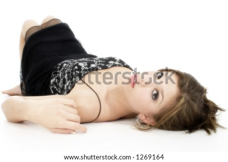 Beautiful young woman in black formal summer dress laying on floor. - stock photo