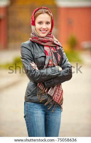 beautiful young woman in black jacket with crossed hands - stock photo