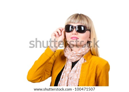 Beautiful young woman in bright jacket with sunglasses isolated on white - stock photo