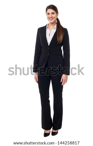 Beautiful young woman in business attire - stock photo