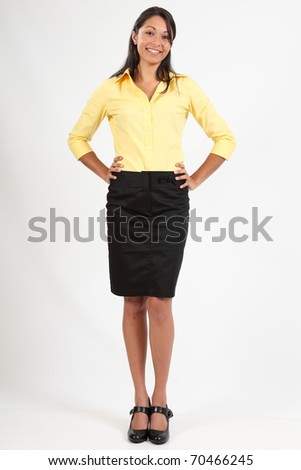 Beautiful young woman in business blouse and skirt - stock photo