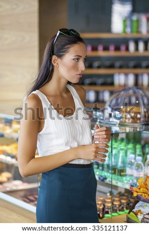 Beautiful young woman in cafe shop - stock photo