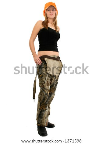Beautiful young woman in camo overalls and tank wearing orange hat - stock photo