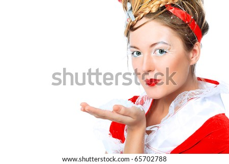 Beautiful young woman in Christmas clothes isolated over white background. - stock photo