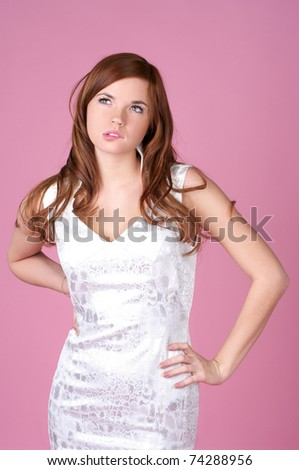 Beautiful young woman in evening gown over red background - stock photo