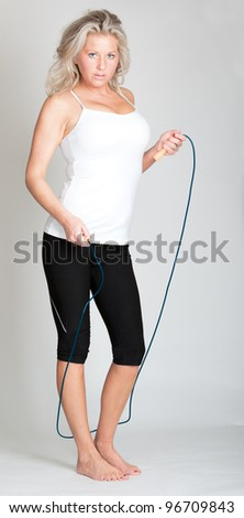 Beautiful young woman in fitness attire - stock photo