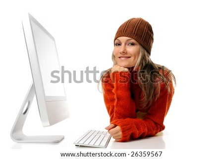 beautiful young woman in front of the computer - stock photo
