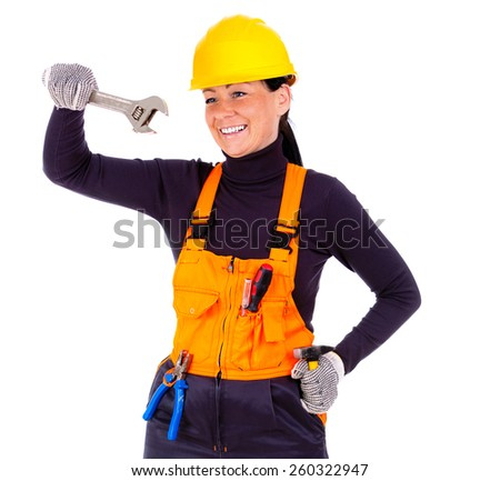 Beautiful young woman in hardhat wearing tool belt and holding wrench, hammer, pliers and screwdriver, Isolated on white background - stock photo