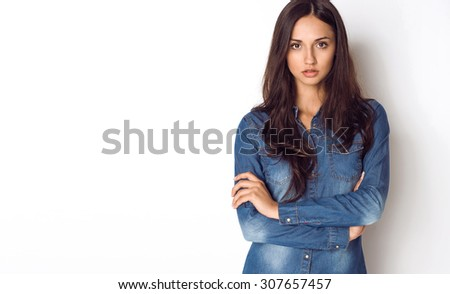 Beautiful young woman in jeans shirt - stock photo