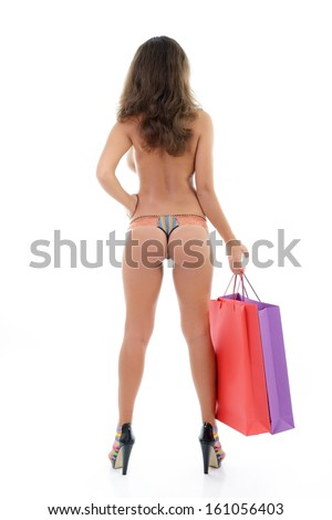 Beautiful young woman in panties only holding shopping bags, full length portrait over white background - stock photo