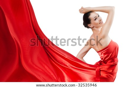 beautiful young woman in red long dress - stock photo