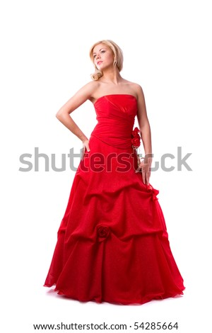 Beautiful young woman in red long dress . Girl in red dress full-length.  Happy woman in red prom dress. - stock photo