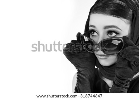 beautiful young woman in retro style . copy space. - stock photo
