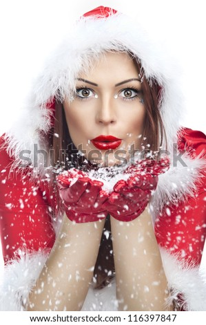 Beautiful young woman in Santa Claus clothes isolated - stock photo