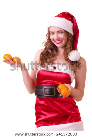 Beautiful young woman in Santa Claus clothes with orange mandarin on white background. - stock photo