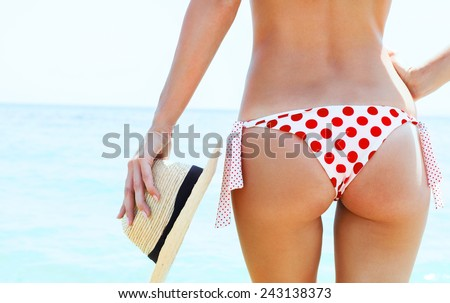 Beautiful young woman in sexy bikini at the beach  - stock photo