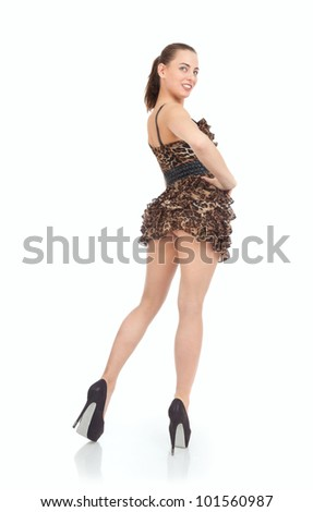 Beautiful young woman in short dress isolated on white - stock photo