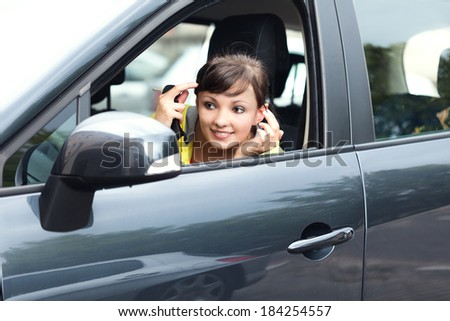 beautiful young woman in the car , makeup - stock photo
