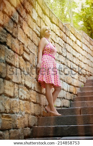 Beautiful young woman in the park - stock photo