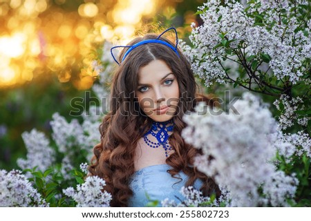 beautiful young woman in the spring looking directly at the camera. - stock photo