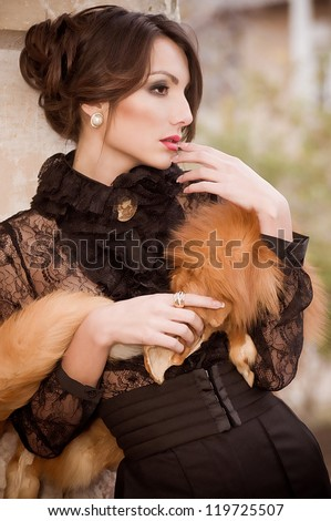 Beautiful young woman in vintage fashion clothes - stock photo