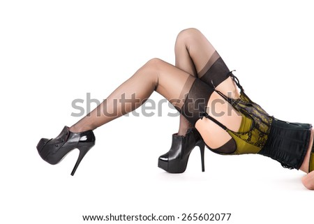 Beautiful young woman in vintage lingerie and high heels, isolated on white background  - stock photo