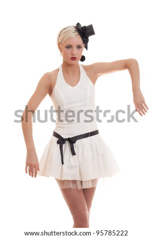 Beautiful young woman in white dress with small hat and black belt is acting as a living doll, isolated on white - stock photo