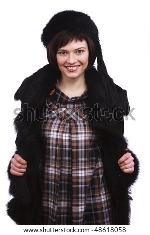 Beautiful young woman in winter coat. Young female in winter clothes. Attractive model in fur jacket. - stock photo