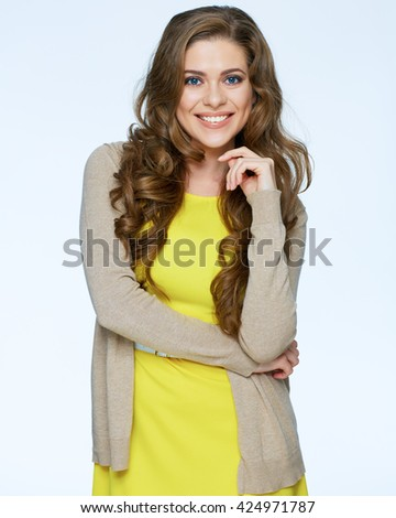 Beautiful young woman in yellow dress posing over white background. Smiling woman. - stock photo