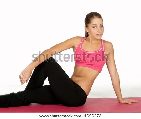 Beautiful Young Woman in Yoga Pose - stock photo