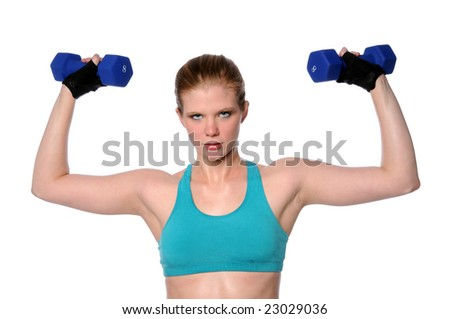 Beautiful young woman lifting dumbbells isolated over a white background - stock photo