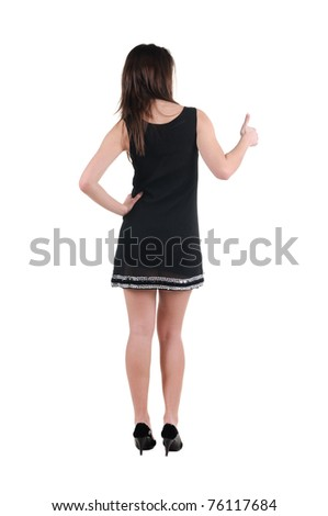 Beautiful young woman looking at wall. Rear view. - stock photo