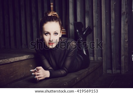 Beautiful young woman lying on the floor - stock photo