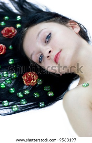 Beautiful young woman lying on the floor isolated on white - stock photo