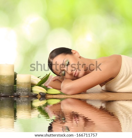 beautiful young woman lying relaxed - stock photo