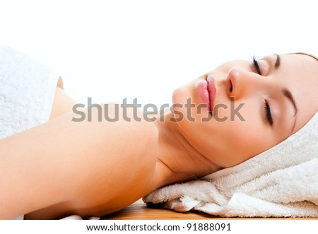 beautiful young woman lying relaxed in the spa salon - stock photo