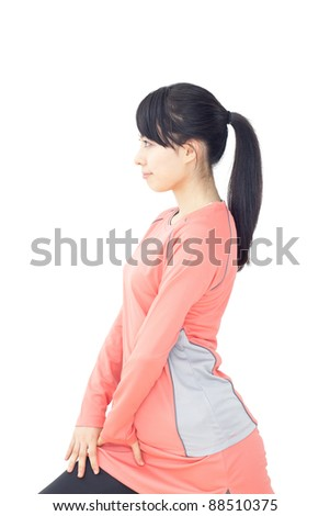 Beautiful young woman makes stretching isolated over white background - stock photo