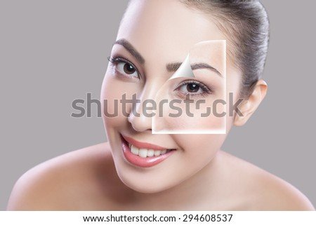 Beautiful young woman on a gray background, beauty concept. retouch before and after.face and eye divided in two parts,poor condition the skin in good condition. Edited with special care and attention - stock photo
