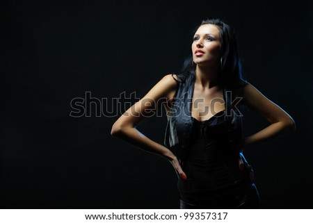 Beautiful young woman on black background - stock photo