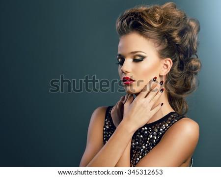 Beautiful young woman on dark background, beauty, glamour - stock photo