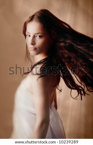beautiful young woman on fantasy background - stock photo