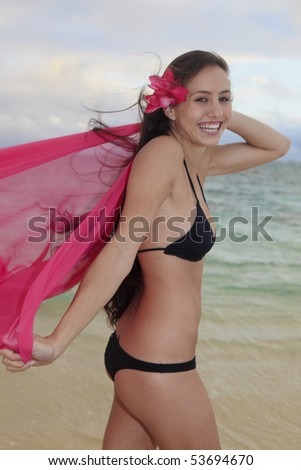 beautiful young woman on lanikai beach at sunrise - stock photo