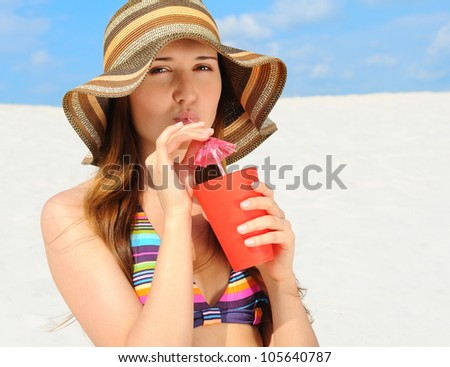 beautiful young woman on the sunny beach - stock photo