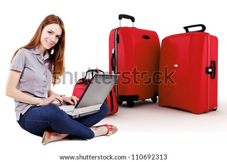beautiful young woman online trip planning with 3d luggage in the background - stock photo