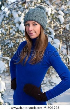 Beautiful young woman outdoor in winter - stock photo