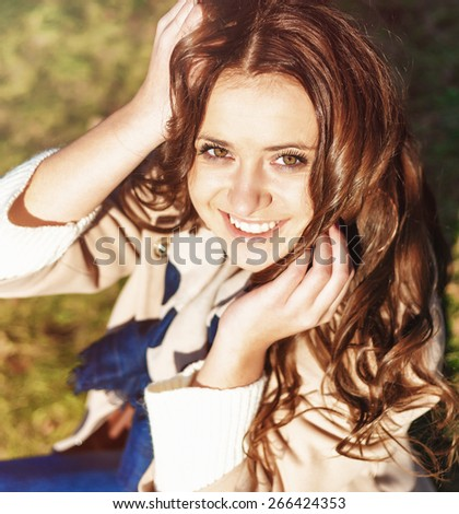 Beautiful Young woman outdoors portrait. Concept of healthy lifestyle and relaxation. Filtered image. - stock photo