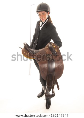 beautiful young woman outfit with horses and a horse saddle - stock photo